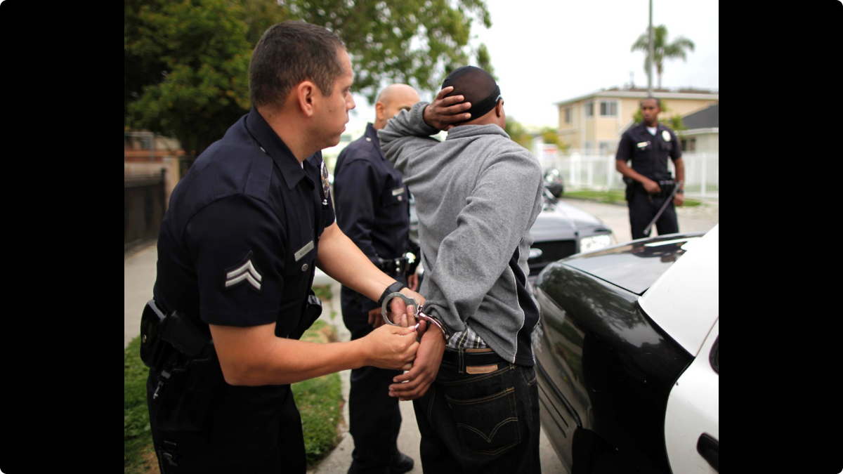120312-national-arrest-handcuffs-police-school-to-prison.jpg.custom1200x675x20